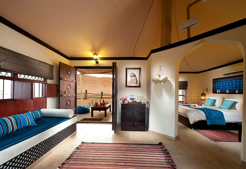 Desert Nights Camp Wahiba Sands Oman Oriental style interior of King size bed and sofa